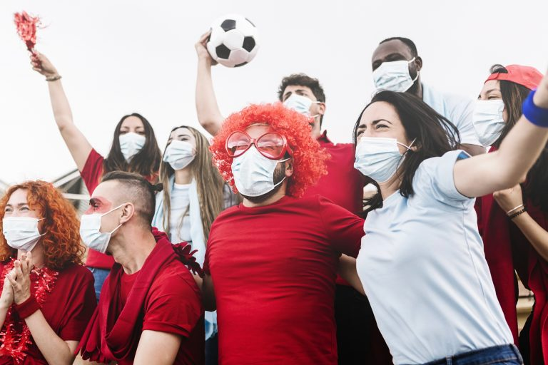 Multiracial group of friends wearing protective face mask screaming and watching soccer match at stadium during the coronavirus pandemic – New normal for live sports conceptNSF Recap: Best Practices for The Ultimate Sports and Entertainment Experiences